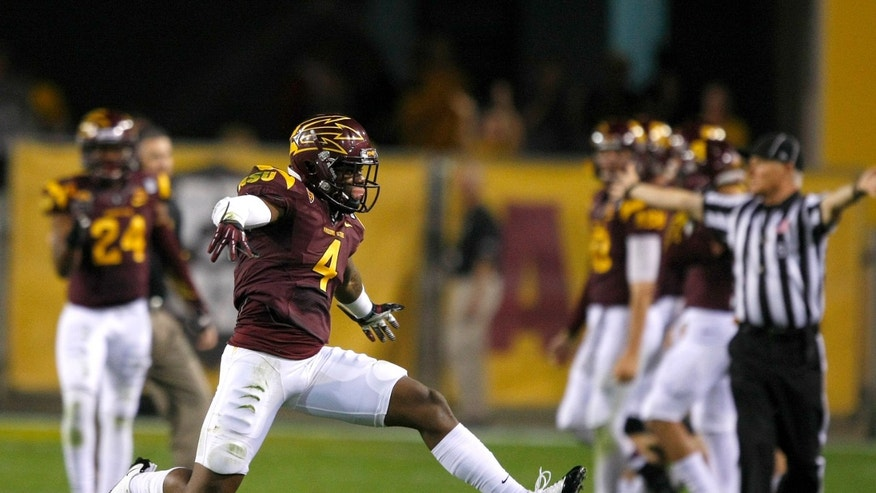 Arizona State safety Alden Darby (4) celebrates after intercepting a pass against Oregon State during the second half of an NCAA college football game on Saturday, Nov. 16, 2013, in Tempe, Ariz. The Sun Devils defeated the Beavers 30-17. (AP Photo/Rick Scuteri)