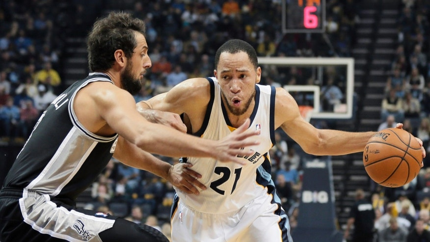 Memphis Grizzlies' Tayshaun Prince (21) dribbles the ball past San Antonio Spurs' Marco Belinelli, of Italy, left, in the first half of an NBA basketball game in Memphis, Tenn., Friday, Nov. 22, 2013. (AP Photo/Danny Johnston)