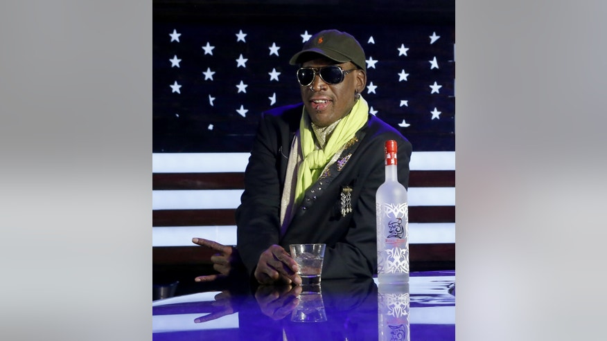 "In this Thursday, Nov. 21, 2013 photo, Dennis Rodman poses during a promotional event to pitch a vodka brand after a launch party  in Chicago. Rodman looked fit and at ease, not squirming even once _ a childhood habit that earned the nickname ""The Worm."" He said he wouldn't talk about his relationship with Kim or North Korean politics, including its horrific human-rights record and secretive nuclear weapons program.(AP Photo/Charles Rex Arbogast)"