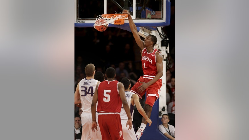 Indiana's Noah Vonleh, right, dunks the ball during the first half of an NCAA college basketball game against Washington, Thursday, Nov. 21, 2013, in New York. (AP Photo/Seth Wenig)