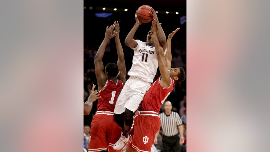 Washington's Mike Anderson, center, shoots between Indiana's Devin Davis, right, and Noah Vonleh during the first half of an NCAA college basketball game on Thursday, Nov. 21, 2013, in New York. (AP Photo/Seth Wenig)