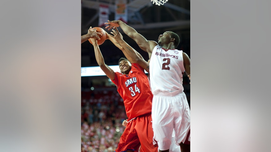SMU's Ben Moore (34) reaches up for the rebound with Arkansas' Alandise Harris (2) during the second half of an NCAA college basketball game in Fayetteville, Ark., Monday, Nov. 18, 2013. Arkansas won 89-78. (AP Photo/Sarah Bentham)
