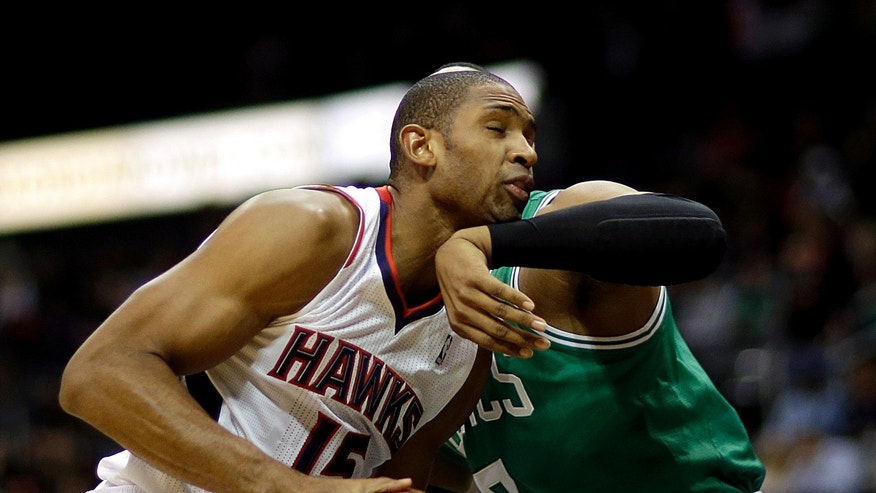 Atlanta Hawks' Al Horford, left, collides with the arm of Boston Celtics' Jared Sullinger during the first quarter of an NBA basketball game, Saturday, Nov. 23, 2013, in Atlanta. (AP Photo/David Goldman)