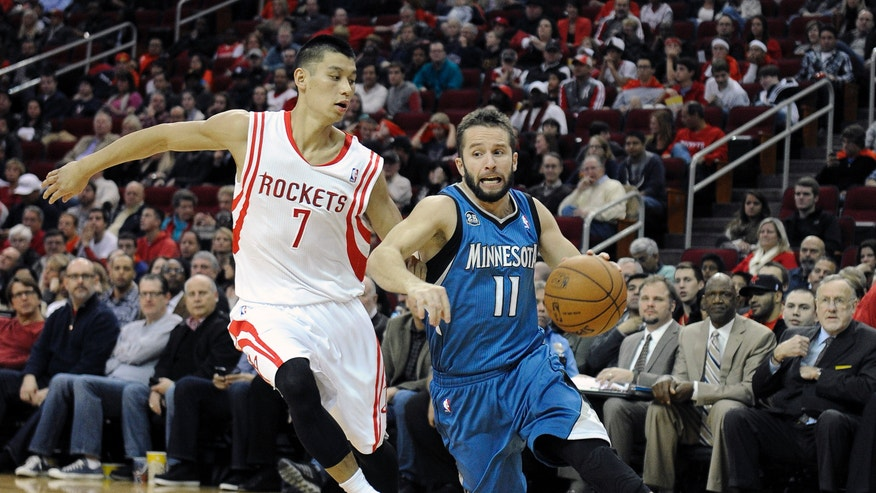 Minnesota Timberwolves' J.J. Barea (11) drives the ball around Houston Rockets' Jeremy Lin (7) in the first half of an NBA basketball game Saturday, Nov. 23, 2013, in Houston. (AP Photo/Pat Sullivan)
