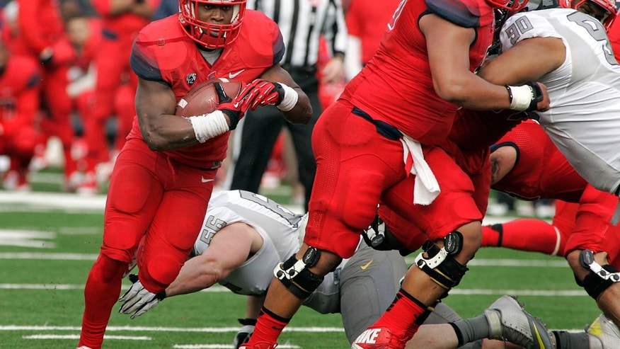 Arizona's Ka'Deem Carey (25) runs around the right side against Oregon for a short gain in the first half of an NCAA college football game on Saturday, Nov. 23, 2013, in Tucson, Ariz. (AP Photo/John MIller)
