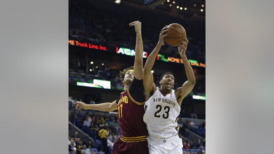New Orleans Pelicans power forward Anthony Davis (23) pulls down a rebound in front of Cleveland Cavaliers center Anderson Varejao (17) in the first half of an NBA basketball game in New Orleans, Friday, Nov. 22, 2013. (AP Photo/Gerald Herbert)