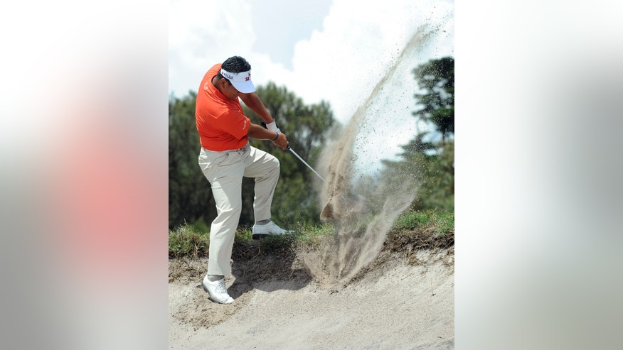 K.J. Choi from South Korea hits out of a bunker on the second hole during the third round of the World Cup of Golf at Royal Melbourne Golf Course in Australia, Saturday, Nov. 23, 2013. (AP Photo/Andy Brownbill)