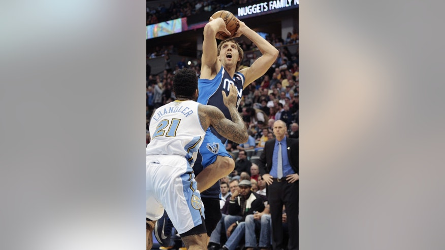 Dallas Mavericks forward Dirk Nowitzki (41) shoots against Denver Nuggets forward Wilson Chandler (21) during the first quarter of an NBA basketball game in Denver on Saturday, Nov. 23, 2013. (AP Photo/Joe Mahoney)