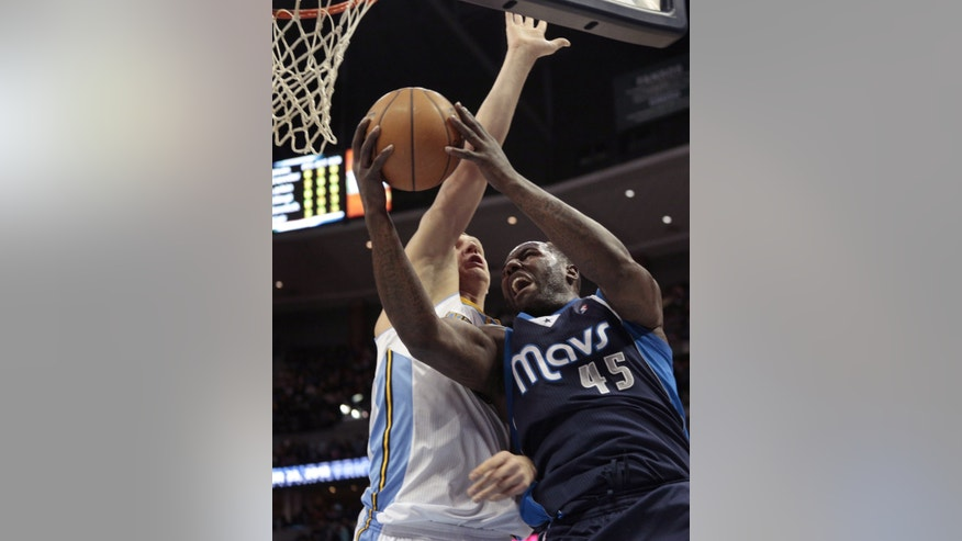 Dallas Mavericks center DeJuan Blair (45) drives to the basket against Denver Nuggets center Timofey Mozgov (25) during the second quarter of an NBA basketball game in Denver on Saturday, Nov. 23, 2013. (AP Photo/Joe Mahoney)