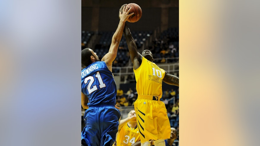 Presbyterian's Jordan Downing, left, battles West Virginia's Eron Harris (10) for a rebound during the first half of an NCAA college basketball game Saturday, Nov. 23, 2013, in Morgantown, W.Va. (AP Photo/Andrew Ferguson)