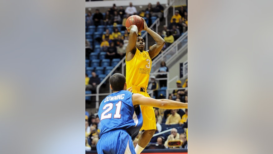 West Virginia's Juwan Staten (3) shoots over Presbyterian's Jordan Downing (21) during the first half of an NCAA college basketball game Saturday, Nov. 23, 2013, in Morgantown, W.Va. (AP Photo/Andrew Ferguson)