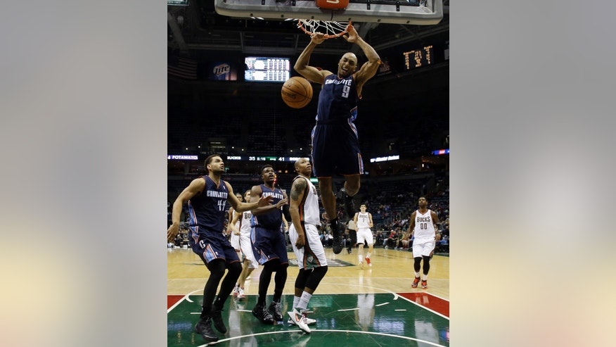 Charlotte Bobcats' Gerald Henderson dunks during the first half of an NBA basketball game against the Milwaukee Bucks, Saturday, Nov. 23, 2013, in Milwaukee. (AP Photo/Morry Gash)