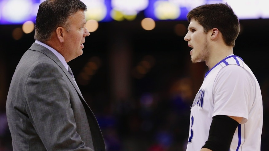 Creighton coach Greg McDermott, left, instructs his son Creighton forward Doug McDermott (3) in the first half of an NCAA college basketball game against Tulsa in Omaha, Neb., Saturday, Nov. 23, 2013. (AP Photo/Nati Harnik)