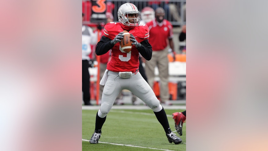Ohio State quarterback Braxton Miller drops back to pass against Indiana during the first quarter of an NCAA college football game Saturday, Nov. 23, 2013, in Columbus, Ohio. (AP Photo/Jay LaPrete)