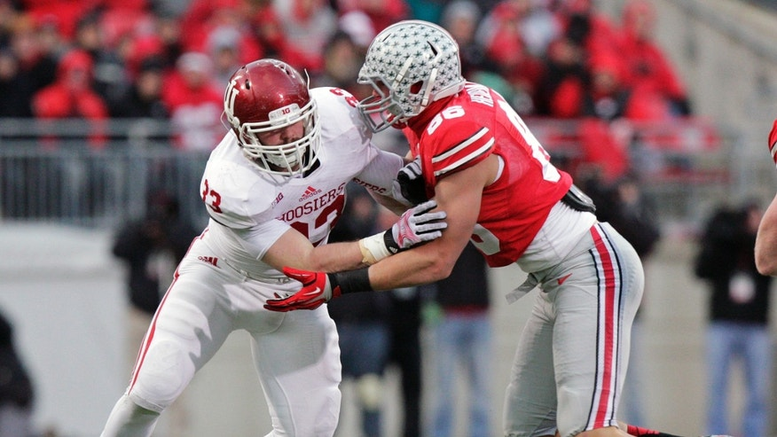Indiana defensive end Zack Shaw, left, fights off the block of Ohio State tight end Jeff Heuerman during the second quarter of an NCAA college football game Saturday, Nov. 23, 2013, in Columbus, Ohio. (AP Photo/Jay LaPrete)