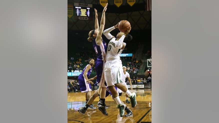 Baylor guard Odyssey Sims (0), right, shoots over Northwestern State guard Meredith Graf (14), left, in the first half of an NCAA college basketball game, Friday, Nov. 22, 2013, in Waco, Texas. (AP Photo/Waco Tribune Herald, Michael Bancale)