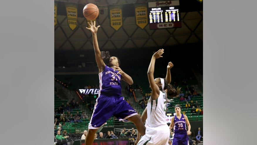 Northwestern State forward Trudy Armstead (31), left, shoots over Baylor forward Chardonae Fuqua' (3), right, in second half of an NCAA college basketball game, Friday, Nov. 22, 2013, in Waco, Texas. (AP Photo/Waco Tribune Herald, Michael Bancale)