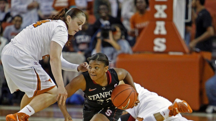 Stanford guard Amber Orrange looks to pass after she recovered a loose ball against Texas guards Chassidy Fussell, left, and Krystle Henderson, right, during the first period of an NCAA college basketball game Saturday, Nov. 23, 2013, in Austin, Texas. (AP Photo/Michael Thomas)