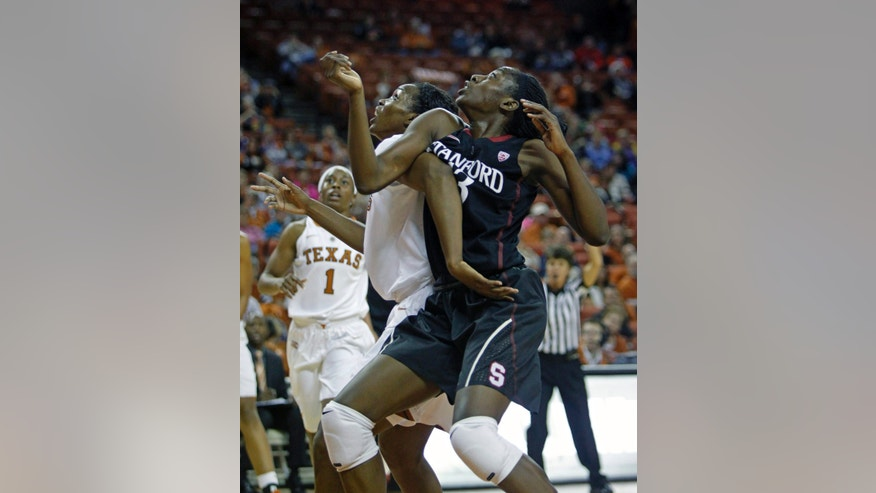 Stanford forward Chiney Ogwumike, right, fights for position with Texas forward Nneka Enemkpali during the first period of an NCAA college basketball game Saturday, Nov. 23, 2013, in Austin, Texas. (AP Photo/Michael Thomas)