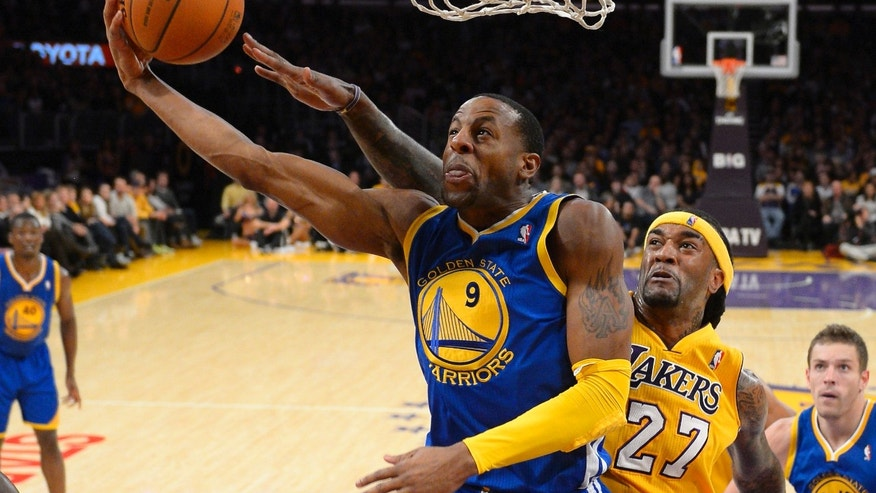 Golden State Warriors forward Andre Iguodala, left, puts up a shot as Los Angeles Lakers center Jordan Hill defends during the first half of an NBA basketball game, Friday, Nov. 22, 2013, in Los Angeles. (AP Photo/Mark J. Terrill)