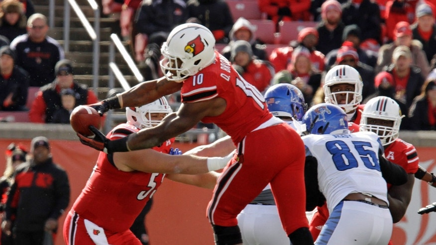 Louisville running back Dominique Brown (10) makes a catch against Memphis during the first half of an NCAA college football game in Louisville, Ky., Saturday, Nov. 23, 2013. (AP Photo/Garry Jones)