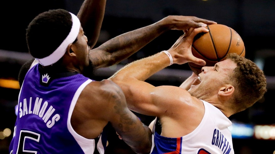 Sacramento Kings forward John Salmons, left, blocks a shot by Los Angeles Clippers forward Blake Griffin during the first half of an NBA basketball game in Los Angeles, Saturday, Nov. 23, 2013. (AP Photo/Chris Carlson)