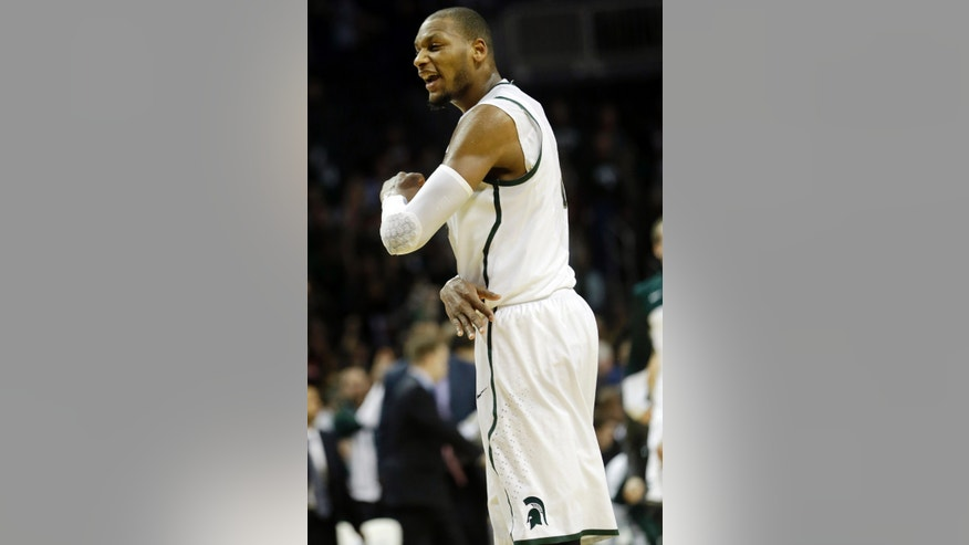 Michigan State's Adreian Payne celebrates after making a three-point basket during the first half of a Coaches vs. Cancer NCAA college basketball game against the Virginia Tech, Friday, Nov. 22, 2013, in New York. (AP Photo/Frank Franklin II)