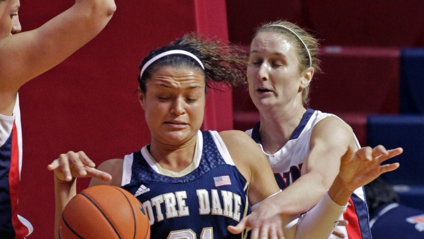 Notre Dame's Kayla McBride (21) and Penn's Katy Allen (23) fight for a loose ball in the first half of an NCAA college basketball game Saturday Nov. 23, 2013, in Philadelphia. Notre Dame won 76-54.  (AP Photo/H. Rumph Jr)