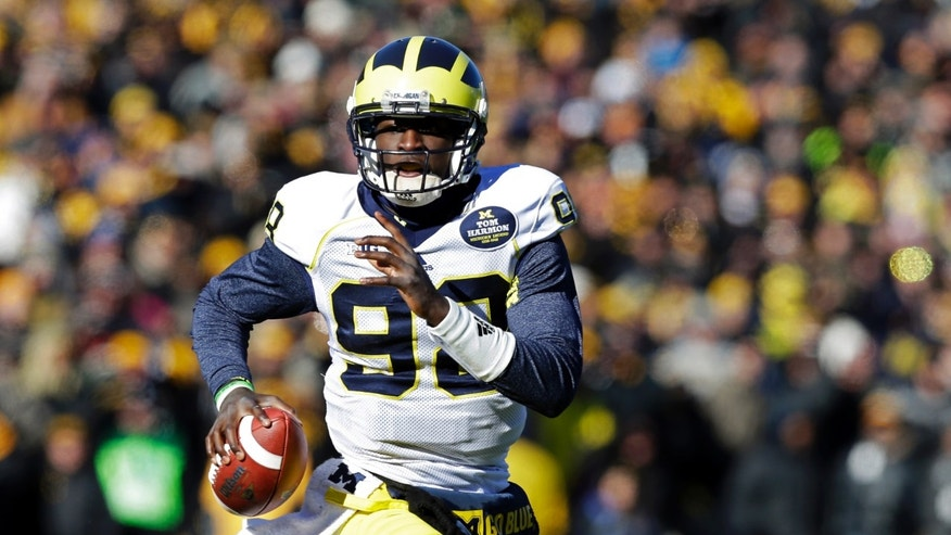 Michigan quarterback Devin Gardner looks to pass during the first half of an NCAA college football game against Iowa, Saturday, Nov. 23, 2013, in Iowa City, Iowa. (AP Photo/Charlie Neibergall)