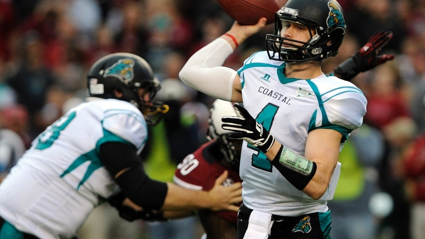 Coastal Carolina quarterback Alex Ross (4) passes down field during the first half of an NCAA college football game against South Carolina, Saturday, Nov. 23, 2013 in Columbia, S.C. (AP Photo/Stephen Morton)