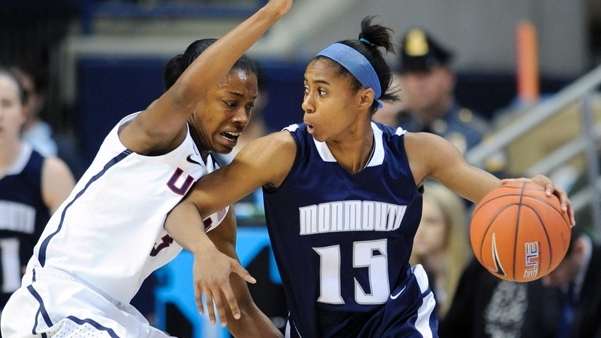Connecticut's Brianna Banks (13) guards Monmouth's Jasmine Walker during the first half of an NCAA college basketball game, in Storrs, Conn., on Saturday, Nov. 23, 2013. (AP Photo/Fred Beckham)