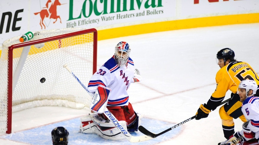 New York Rangers goalie Cam Talbot (33) stops the shot of Nashville Predators forward Gabriel Bourque (57) in the second period of an NHL hockey game on Saturday, Nov. 23, 2013, in Nashville, Tenn. (AP Photo/Mike Strasinger)