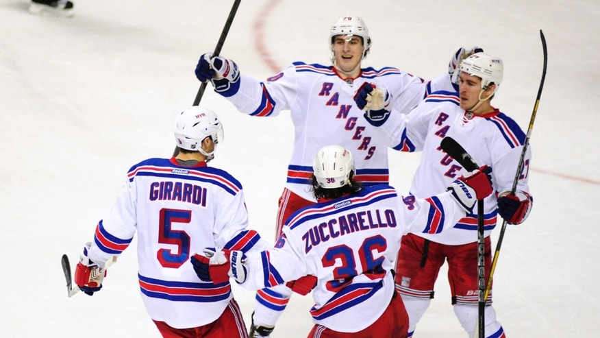 The New York Rangers celebrate a goal by defenseman Ryan McDonagh, right, in the second period of an NHL hockey game against the Nashville Predators, Saturday, Nov. 23, 2013, in Nashville, Tenn. (AP Photo/Mike Strasinger)