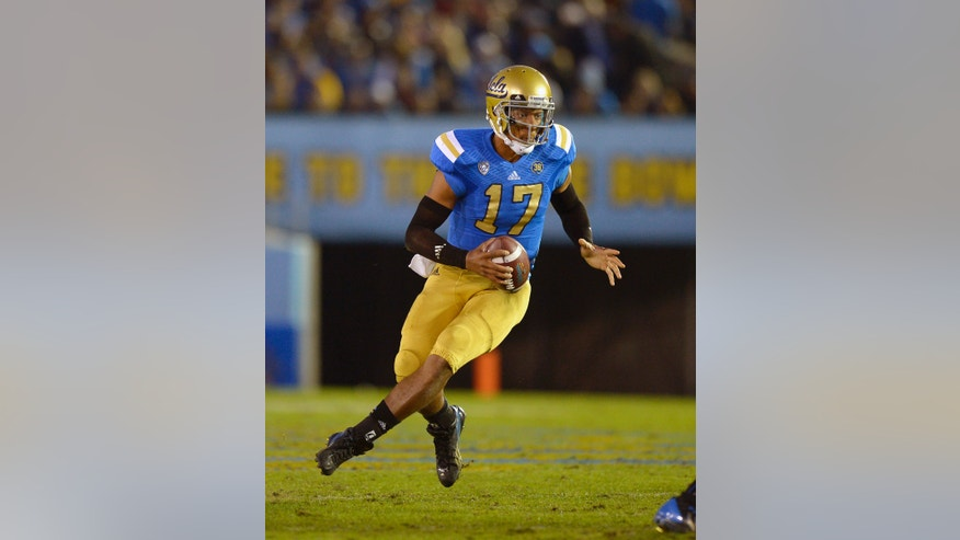 UCLA quarterback Brett Hundley runs the ball during the first half an NCAA college football game against Arizona State, Saturday, Nov. 23, 2013, in Pasadena, Calif. (AP Photo/Mark J. Terrill)