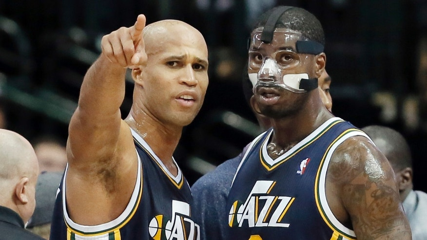 Utah Jazz Richard Jefferson (24) goes over a play with teammate Marvin Williams (2) during a timeout in the second half of an NBA basketball game against the Dallas Mavericks on Friday, Nov. 22, 2013, in Dallas. Dallas won 103-93. (AP Photo/Brandon Wade)