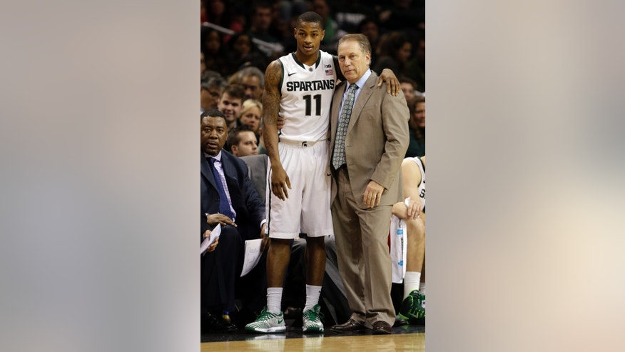 Michigan State's Keith Appling (11) talks to head coach Tom Izzo during the second half of a Coaches vs. Cancer NCAA basketball game against the Virginia Tech Saturday, Nov. 23, 2013, in New York.  (AP Photo/Frank Franklin II)