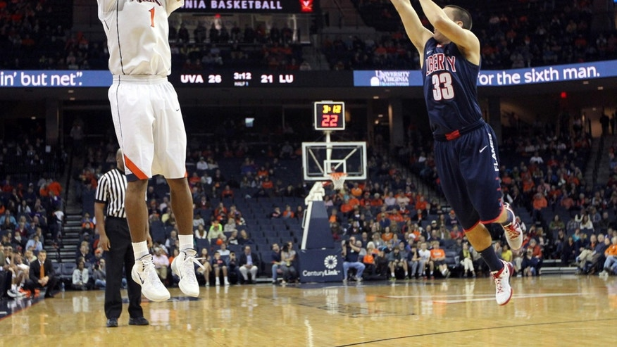 Virginia guard Justin Anderson (1) shoots a 3-point basket over Liberty guard John-Caleb Sanders (33) during the first half of an NCAA college basketball game Saturday, Nov. 23, 2013, in Charlottesville, Va. (AP Photo/Andrew Shurtleff)