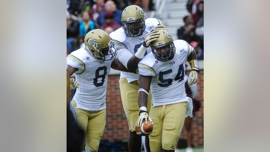 Georgia Tech linebacker Quayshawn Nealy (54) celebrates his fumble recovery and touchdown with cornerback Louis Young (8) and running back Tony Zenon during the second quarter of an NCAA college football game against Alabama A&M , Saturday, Nov. 23, 2013, in Atlanta. (AP Photo/John Amis)