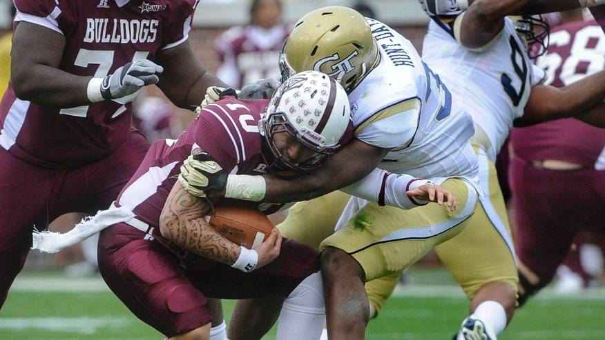Alabama A&M quarterback Jaymason Lee (10) is sacked by Georgia Tech linebacker Jabari Hunt-Days (32) during the second quarter of an NCAA college football game, Saturday, Nov. 23, 2013, in Atlanta. (AP Photo/John Amis)