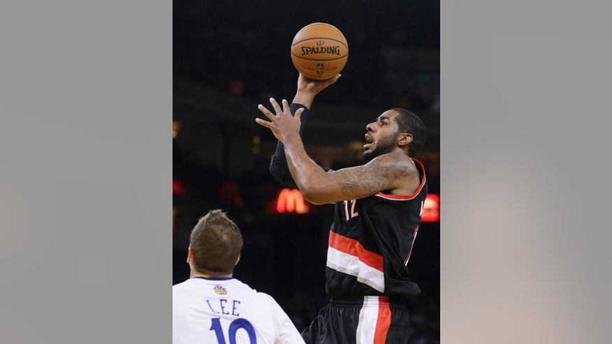 Portland Trail Blazers' LaMarcus Aldridge (12) shoots over Golden State Warriors' David Lee during the first half of an NBA basketball game Saturday, Nov. 23, 2013, in Oakland, Calif. (AP Photo/Ben Margot)