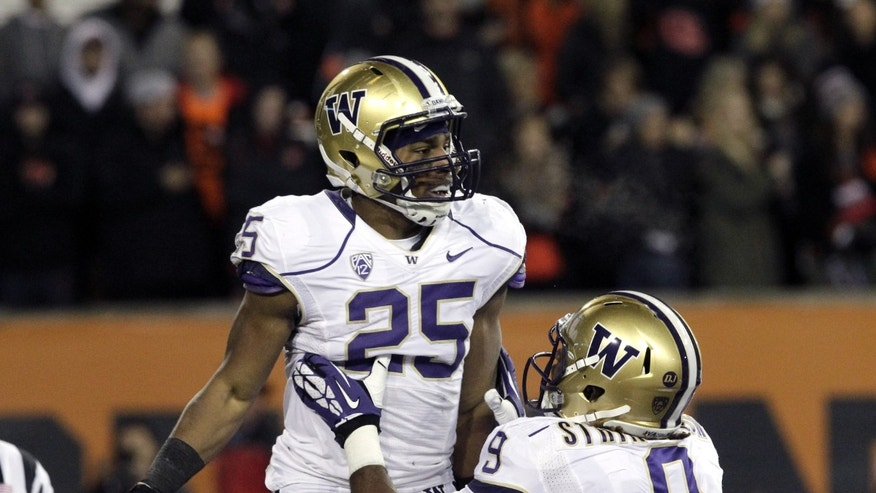 Washington running back Bishop Sankey, left, celebrates his touchdown with teammate Demore'ea Stringfellow during the first half of an NCAA college football game against Oregon Statein Corvallis, Ore., Saturday, Nov. 23, 2013.  (AP Photo/Don Ryan)