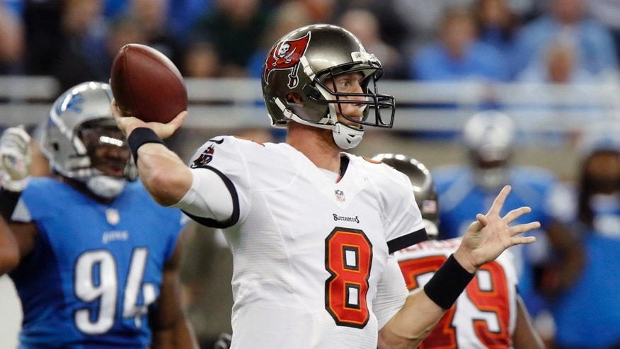 Tampa Bay Buccaneers quarterback Mike Glennon (8) throws during the first quarter of an NFL football game against the Detroit Lions at Ford Field in Detroit, Sunday, Nov. 24, 2013. (AP Photo/Duane Burleson)