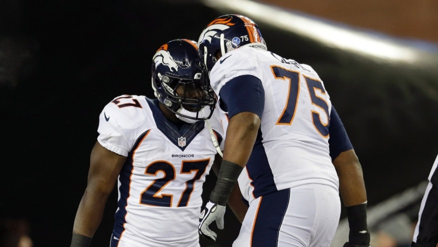 Denver Broncos running back Knowshon Moreno (27) celebrates his touchdown with Chris Clark (75) in the first quarter of an NFL football game against the New England Patriots Sunday, Nov. 24, 2013, in Foxborough, Mass. (AP Photo/Steven Senne)