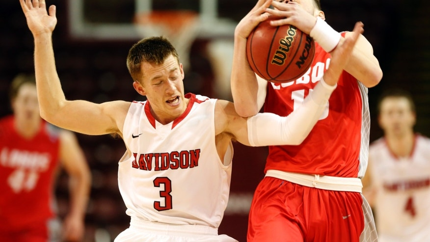 Davidson's Brian Sullivan, left, battles for control of the ball with New Mexico's Cullen Neal in the second half at the Charleston Classic NCAA college basketball tournament in Charleston, S.C., Sunday, Nov. 24, 2013.  (AP Photo/Mic Smith)