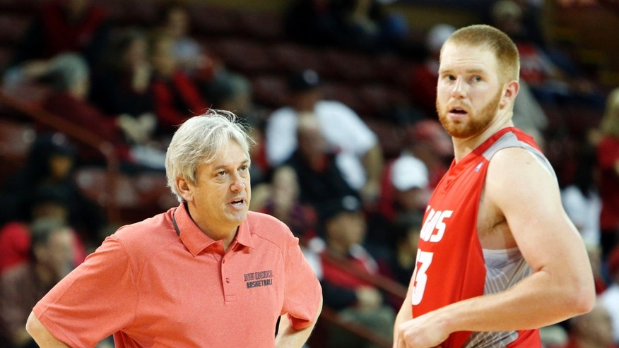 New Mexico head coach Craig Neal, left, talks with player Alex Kirk in the second half against Davidson at the Charleston Classic NCAA college basketball tournament in Charleston, S.C., Sunday, Nov. 24, 2013.  (AP Photo/Mic Smith)