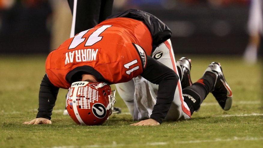 Georgia Bulldogs quarterback Aaron Murray (11) reacts after he is injured after a hit by Kentucky Wildcats defensive end Za'Darius Smith (not pictured) in the first half of their game at Sanford Stadium Saturday night in Athens, Ga., Nov. 23, 2013. Murray, a senior, threw four touchdown passes and one interception in the first half of his final home game of the season. (AP Photo/Atlanta Journal-Constitution, Jason Getz)