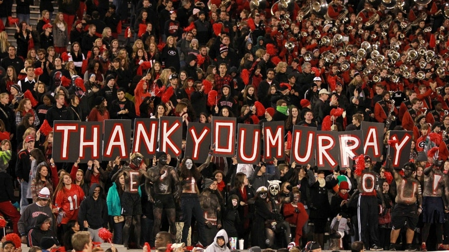 "Georgia Bulldogs fans show their appreciation for Georgia quarterback Aaron Murray with a sign reading, ""Thank You Murray,"" after their win over the Kentucky Wildcats at Sanford Stadium Saturday night Nov. 23, 2013 in Athens, Ga. (AP Photo/Atlanta Journal-Constitution, Jason Getz)"