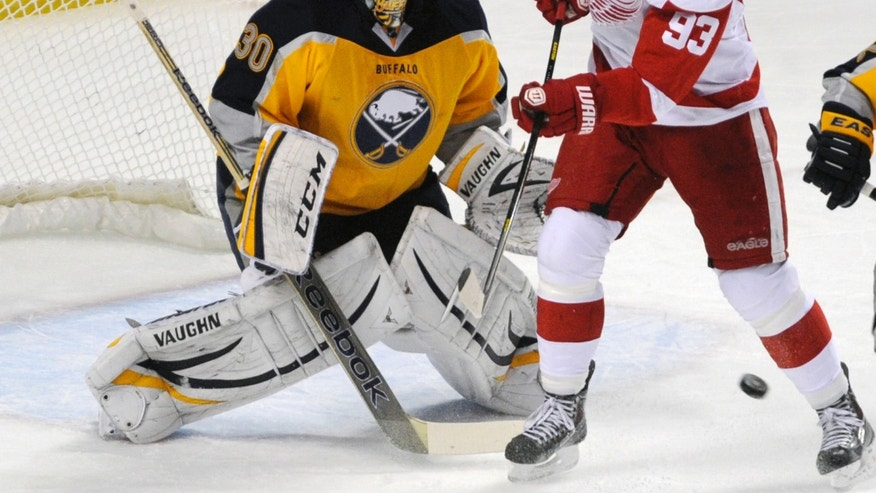 Buffalo Sabres goaltender Ryan Miller (30) reacts as Detroit Red Wings right winger Johan Franzen (93), of Sweden, tries to deflect the puck during the first period of an NHL hockey game in Buffalo, N.Y., Sunday, Nov. 24, 2013. (AP Photo/Gary Wiepert)