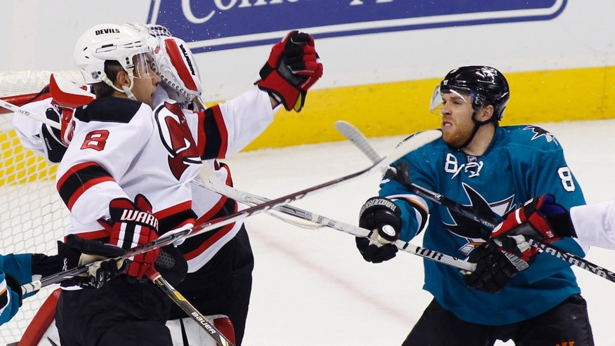 New Jersey Devils' Dainus Zubrus (8), left, struggles with San Jose Sharks' Joe Pavelski, right,during the second period of an NHL hockey game, Saturday, Nov. 23, 2013 i San Jose, Calif. (AP Photo/George Nikitin)