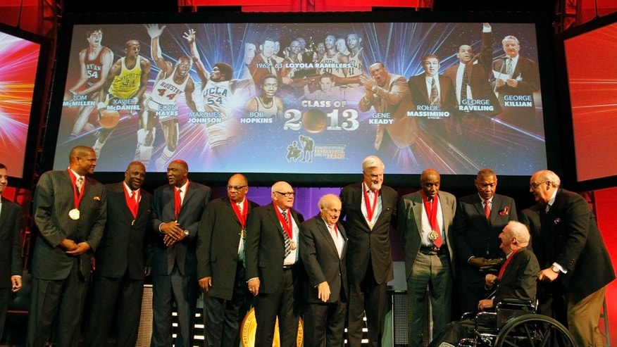 Inductees from left, Marques Johnson, Xavier McDaniel, Elvin Hayes, George Raveling, Gene Keady, Rollie Massimino, Tom McMillen, Bob Hopkins, Les Hunter and George Killian gather on stage at the conclusion of their induction into the National Collegiate Basketball Hall of Fame, Sunday, Nov. 24, 2013, in Kansas City, Mo. (AP Photo/Colin E. Braley)